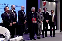 Inamori (center) receives a Ph.D. honoris causa from EMLYON Business School.