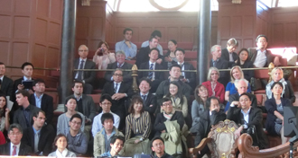 The audience listening to the lecture